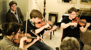 Composer Carter Callison (in hat!) with violinists Audrey Lee,Matthew Lammers, Macek Burdzy (Photo David Gorton)
