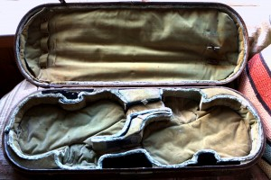 The double case (for the two Da Salo violins), still with the water damage from the riverboat accident of December 1868